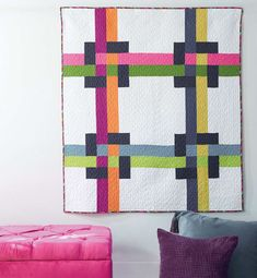 Iberian Tiles Quilt Pattern by Catherine Redford features simple pieced squares and rectangles to create this woven quilt pattern effect.