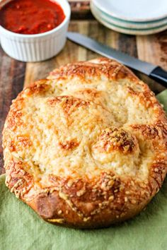 Easy Asiago Cheese Bread - This easy asiago cheese bread is made from store-bought pizza dough so it's super simple to put together. Simply split dough in half, sprinkle freshly-shredded asiago cheese on top and bake for 15-20 minutes. That's it! It's the perfect accompaniment to your favorite pasta or soup.