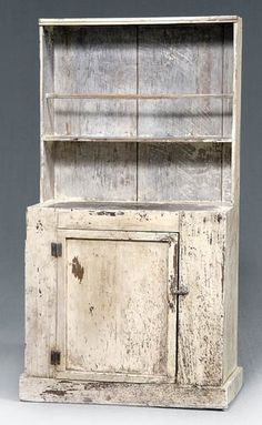single-case construction with single door and open interior, probably North Carolina, late 19th century, 59 x 32-1/2 x 16 in. Old white painted surface with extensive wear and abrasions, undisturbed backboards with cut nails. Provenance: Found in Lincoln County, North Carolina; The Collection of Tom and Ann Hixson.