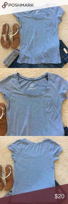 """Mango Tee Mango Tee. Super cute wardrobe staple. Classic tee, short sleeves, one pocket, scoop neckline. Laying flat approx 24"""" shoulder to hem, approx 16.5"""" pit to pit. 66 cotton 34 polyester. Size S. Excellent condition. Mango Tops Tees - Short Sleeve"""