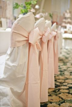 Elegant Pale pink chair bow ties without white covers on brown wood chairs?