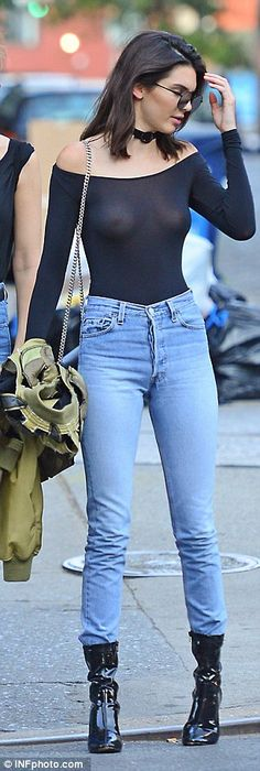 On point:Making a boob of herself aside, the catwalk star's outfit was impeccably on-trend with Kendall pairing the bodysuit with a pair of high wasited salvaged button fly jeans by Re/Done