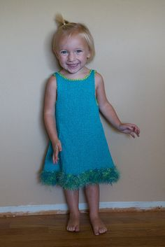Knit dress. Yarn Girl's pattern. Each of my girls has LOVED wearing this dress. The cat also likes it.