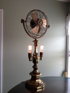 Handmade Steampunk brass light fan made from antique vintage recycled parts for a fan with an industrial victorian decoration functional art...
