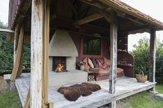 This particular fireplace is not super efficient but will still cast warmth into this comfy space. A Rumford fireplace would give the same feel with more heat (per piece of wood burned). Photo is from Living Large in our Little House Outdoor Decor, Interior And Exterior, Outdoor Bed, Garden Deco, Outside Living, Outdoor Rooms, Natural Building, Eco House, Fireplace Decor