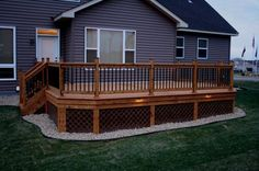 Gravel works well under a deck and provides drainage. Lattice adds a nice finishing touch. Bing Images