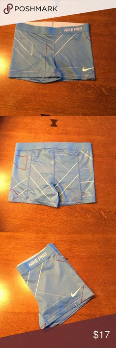 New listing  Nike pro fitted shorts  Cute Nike pro women's shorts in size medium.  Nice light blue color with white/burgundy design.  80% polyester and 20% spandex.  Waist measures approx. 14 1/4 in across and inseam is 3 inches.  Shorts have been gently worn but are in good condition.  Slight cracking to swoosh symbol shown in picture. Nike Shorts