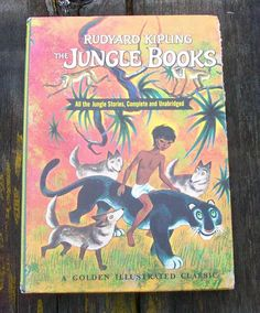 """This listing is for the vintage book """"The Jungle Books"""" by Rudyard Kipling.Illustrated by Tibor Gergely.All the Jungle Stories, Completer and Unabridged.A Golden Illustrated ClassicCopyright 1966215 pagesHardbackPublisher - Golden Press, New YorkMeasures about 7 1/2 inches across by 10 1/4 inches.This book is still in good condition.The third photo shows how the edge of the cover has been worn through, towards the top of the book, exposing the book boards.Pages are still tight.Covers and edges s Vintage Children's Books, Antique Books, Nursery Stories, World Cruise, Story Writer, Disney Nursery, If Rudyard Kipling, Vinyl Dolls, Short Stories"""