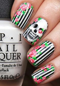 Classy Halloween nails with black and white stripes skulls and roses