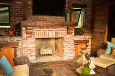 Love the idea of a ground level fireplace rather than the hearth....but I really love the raised area on either sides for storage....notice the detail in the large beam top piece and the cabinet doors and hinges.