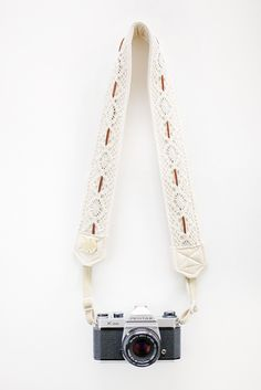camera strap by Bloom Theory, lace and leather, style Dream Catcher; $110