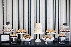 Small wedding cake... then lots of cupcakes. Simple but elegant