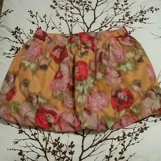 Floral bubble mini skirt Cute but very short. Waist a little more than 14.5 in across Length 14.5 in long It also has pockets. J. Crew Skirts Mini