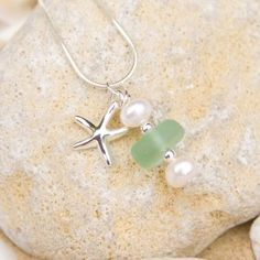 Stunning aqua sea glass piece with silver starfish charm pendant with fresh water pearls from Driftwood Dreaming