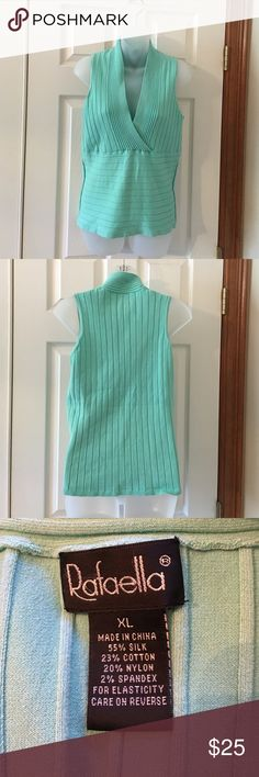 Beautiful silk and cotton sleeveless knit tank. Mint green in color. V neck tank. Euc. Non-smoking home. I have a peach colored one in my closet as well. Rafaella Tops Tank Tops