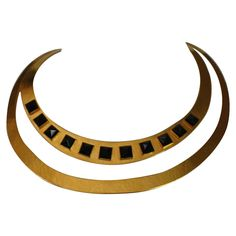 Herve Van Der Straeten Hammered Gold and Black Onyx Torque Necklace | From a unique collection of vintage choker necklaces at https://www.1stdibs.com/jewelry/necklaces/choker-necklaces/