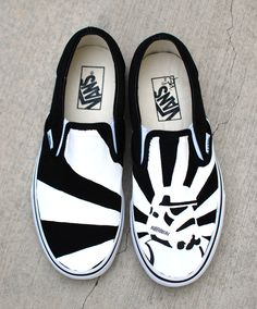 These one-of-a-kind hand-painted Vans Slip ons Feature a black and white storm…