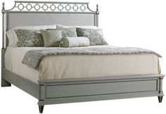 This upholstered headboard has bracelet fretwork and finials in a neutral, gray finish, making it the perfect piece for an airy, elegant bedroom. Furniture > Beds & Headboards > Panel Beds.