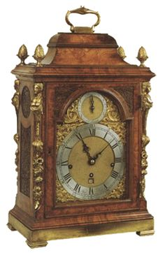 John Ellicott   Bracket Antique Clock A very fine walnut George II walnut musical bracket clock by this famous maker. The case with fine walnut veneers and gilt mounts, mouldings and fretwork and standing on gilt brass mount. The movement with verge escapement, quarter striking and a choice of two melodies, an air and a gavott, played on the hour on 12 bells. The clock with maker's signature to the dial and finely engraved backplate. Circa: 1755