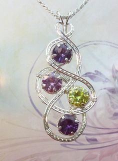 Mothers or Sisters Birthstone Pendant With Up To 5 Gemstones Handmade in Silver… Wire Pendant, Wire Wrapped Pendant, Wire Wrapped Jewelry, Wire Jewelry, Jewelry Crafts, Jewelery, Jewelry Necklaces, Pendant Necklace, Ruby Pendant