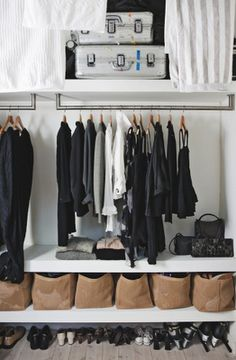 ignoring for a moment the fact that all your clothes need to be black, grey or white, the simple repetition of brown boxes (paper bags?) works well