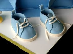 this was a shot of the baby shoes I made out of fondant. I found the template here on CC for converse, but instead of adding all the parts that make them converse, I just left them basic. TFL