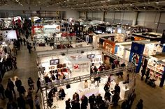 Sold at 123rf: ROME, ITALY APRIL 1st: Video of people visiting stands at Photoshow, international photo and digital imaging exhibition on April 1st 2012 in Rome, Italy. Photoshow had this year an influx of 65,000 visitors in just four days. Stock Photo - 13182520