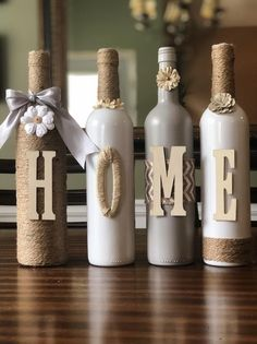 Wine Bottle Decor - Recycled wine bottles crafted with paint, twine, and letters to spell HOME. These particular bottle - Old Wine Bottles, Recycled Wine Bottles, Christmas Wine Bottles, Wine Bottle Art, Painted Wine Bottles, Lighted Wine Bottles, Diy Bottle, Wine Corks, Decorate Wine Bottles