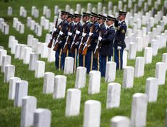 The firing party stands at attention during burial services for Army Pfc. James Holmes of Warren, Ohio, on Thursday at Arlington National Ce...
