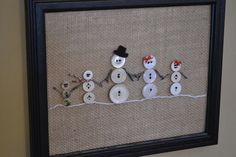 Love this a full #Snowman #family created with White buttons sewn onto burlap and framed. This could be a cute #gift if the family name were sewn into the burlap as well.
