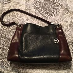 Brighton handbag Brighton handbag. Black and brown leather with silver hardware accents. It's a vintage style. It's still in good used condition. Has lots of life left. Needs a home! Brighton Bags Shoulder Bags