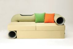 "Sofa with built in cat tunnels. All cat owners repeat after me ""I want one""."