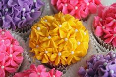 DIY Flower Bouquet Cupcakes. The recipe for the icing is easy and you need one cake tip for these cupcakes - a beginner can do this. Recipe for the icing and tutorial from Life is Sweets here.