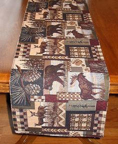Thank you. You will receive a $1 off coupon during checkout. Cabin Fever Rustic Cabin Table Runners and Placemats
