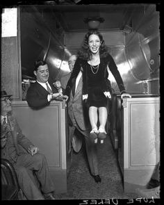 Actress Lupe Velez in a passenger train car, 1929, Chicago, Illinois. Photograph by Chicago Daily News.