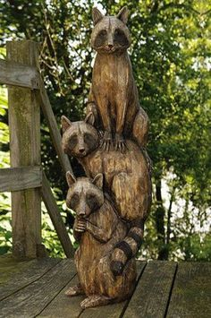 Carved Raccoon's For Cabin Porch