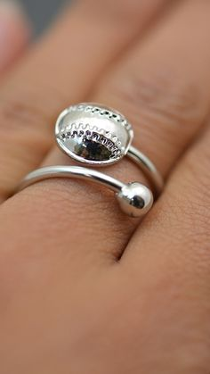 Look how beautiful this silver softball ring looks on! The detailed stitching catches the light to keep the ring shining bright! Give this ring as a softball gift today!