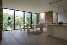 Semi Detached is a minimalist residence located in London, England, designed by Delvendahl Martin Architects.