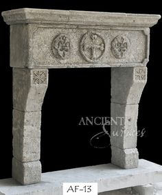 An antique reclaimed French limestone fireplace. Rustic French Provence design.  For more info please visit: http://www.ancientsurfaces.com/Antique-Fireplaces.html