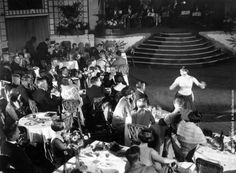 Diners and a cabaret performer in the ballroom at Palm Beach Cafe on the Thames. (Photo by E. Bacon/Topical Press Agency/Getty Images). 12th June 1926