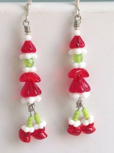 Items similar to Sterling Silver Dancing Grinch Earrings, Whoville Earrings on Etsy Wire Crafts, Holiday Crafts, Jewelry Crafts, Jewelry Ideas, Geek Jewelry, Jewlery, Beaded Jewelry, Handmade Jewelry, Gothic Jewelry
