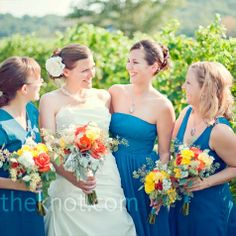 I like these bright multicolored flowers that aren't matchy but look good against the dresses.