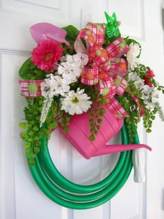 GREEN GARDEN HOSE WREATH - using a watering can, child's shovel, windmill, spring flowers - items you can get from Dollar Store - the hose can be found at Dollar General or Walmart - they have the inexpensive ones that are good for wreaths by Robyn Watkins Casey