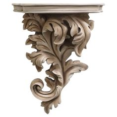 Showcasing an acanthus leaf design and white finish, this classic corbel adds organic appeal to your living room or home library. Product: CorbelConstruction Material: ResinColor: WhiteFeatures: Acanthus leaf designOrganic appealDimensions: H x W x D Steinmetz, Wood Carving Designs, Motif Floral, Classic Furniture, Leaf Design, Joss And Main, Decoration, Wall Decor, Leaves