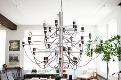 """""""This chandelier is a modern take on a candle chandelier and it's carried by Flos. It was brought to. Candle Chandelier, Modern Chandelier, Dean, Gentlemans Quarters, Soho Loft, Overhead Lighting, Home Photo, Home Look, Lighting Design"""