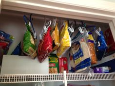Organize your pantry!  No more broken chips, no more buried bags and you free up a pantry shelf!  You can use kid sized pant hangers as chip clips and then hang them on a shower curtain rod in the top of your pantry. You see every bag and they aren't getting smushed and broken!