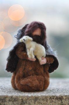 Shepard and baby lamb