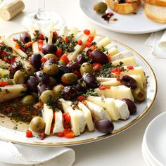 Marinated Olive & Cheese Ring Recipe -We love to make Italian meals into celebrations, and an antipasto always kicks off the party. This one is almost too pretty to eat, especially when sprinkled with pimientos, fresh basil and parsley. —Patricia Harmon, Baden, Pennsylvania
