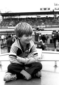 RICHMOND, VA - FEBRUARY 22: Dale Earnhardt Jr. sits atop a camper watching the race during the Richmond 400 race on February 22, 1981 at the Richmond Fairgrounds Raceway in Richmond, Virginia.