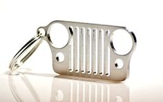 Made in America Stainless Steel Jeep Grill Key Chain. The perfect Jeep Wrangler Accessories - http://automotive.wegetmore.com/made-in-america-stainless-steel-jeep-grill-key-chain-the-perfect-jeep-wrangler-accessories/